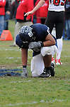 Adalberto Suarez takes a moment after a hard fought battle against Aurora Christian in the 2012 state playoffs at Plunkett.