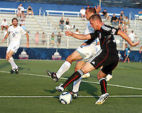 Danny Allsopp #9 of D.C. United shoots past Anthony Calvano #23 of the Harrisburg City Islanders during a US Open Cup match at the Maryland Soccerplex on July 21 2010, in Boyds, Maryland. United won 2-0.