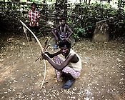 Armed with bows and arrow, a local villager from the Balighato village of Kalinga Nagar area is seen keeping a tight vigil at the entrance of their village to guard it against company officials or police coming in to their village.