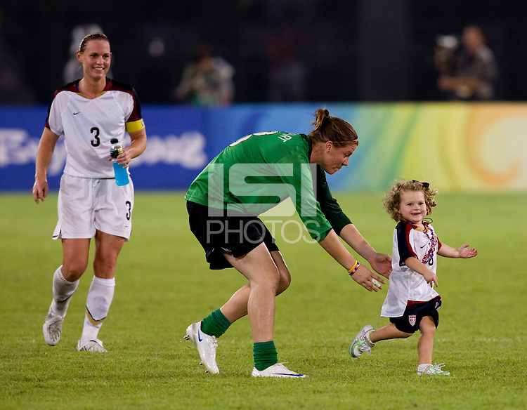 USWNT goalkeeper Nicole Barnhart chases Rylie Rampone with her mom, Christie, close behind after playing at Worker's Stadium.  The USWNT defeated Japan, 4-2, during the semi-finals of the Beijing 2008 Olympics in Beijing, China.
