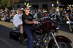 STURGIS, SOUTH DAKOTA - AUGUST 2010:  Motorcyclists ride down Main Street in downtown Sturgis, South Dakota during the 70th annual Sturgis Motorcycle Rally held in the Black Hills.  The attendance estimates were placed between 500, 000 and 700,000 bikers.