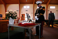 PUNTA GORDA, FL -- March 13, 2008 -- Former Marine Sherman Lightle of Port Charlotte, who served from 1948-57, looks at the dress uniform of former Marine Eric Hall at the Faith Lutheran Church in Punta Gorda, Fla., on Thursday, March 13, 2008.  Hall went missing on Feb. 3 after having a flashback to his time in Iraq, and was found dead weeks later by the Vietnam veteran volunteers in a culvert.