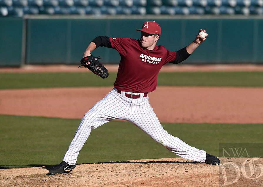 NWA Democrat-Gazette/MICHAEL WOODS @NWAMICHAELW<br /> University of Arkansas pitcher Evan Lee (27) fires a pitch Friday, January 27, during Razorback baseball teams first practice for the 2017 season at Baum Stadium.