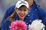 13 October 2012: Kansas cheerleader. The Oklahoma State University Cowboys played the University of Kansas Jayhawks at Memorial Stadium in Lawrence, Kansas in a 2012 NCAA Division I Football game.