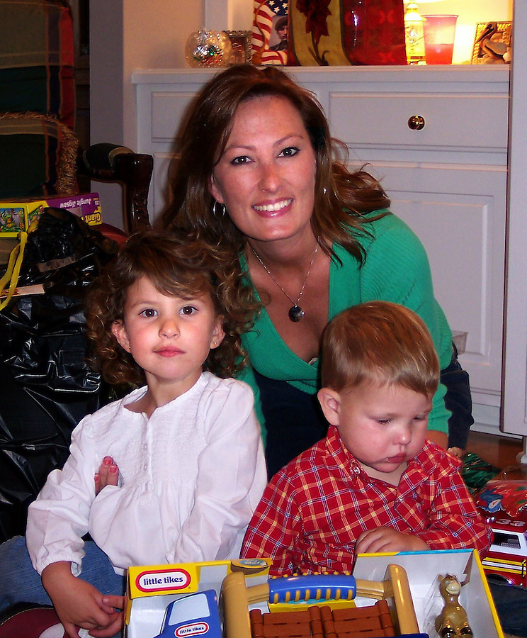 Capt. Brad Velotta's family - wife Jodi (c.) and children Hudson (r.) and Sophia (l.) - on a Christmas separated from their husband and father. Courtesy of the Velotta family.