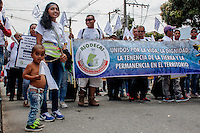 A kid carry the peace flag during the rally for a negotiated solution to the conflict and commemoration of the Day of memory of victims in Medellín, Colombia on 09/04/2015
