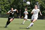 11 October 2009: Duke's KayAnne Gummersall (13) and Florida State's Toni Pressley (23). The Duke University Blue Devils played the Florida State University Seminoles to a 0-0 tie after overtime at Koskinen Stadium in Durham, North Carolina in an NCAA Division I Women's college soccer game.