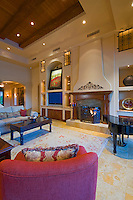 Mediterranean decore family room featuring beamed ceilings, elegant furnishings and a lovely fireplace by a grand piano