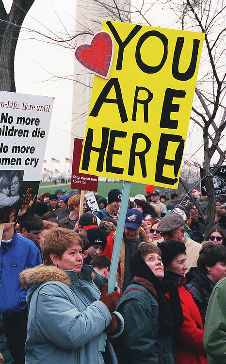 01/22/98.ROE V. WADE ANNIVERSARY--On the 25th anniversary of Roe v. Wade, the case which established the legal right to abortion, Denise Liss of Woodbridge, Va., holds her sign as she waits for the March for Life to begin near the Ellipse..CONGRESSIONAL QUARTERLY PHOTO BY SCOTT J. FERRELL