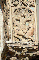 13th century Medieval Romanesque Sculptures from the facade of St Mark's Basilica, Venice, depicting a youth sitting on a bovine.