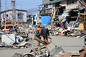 April 1st, 2011, Miyako, Japan - A couple walks by debris and damaged houses in Miyako City, Iwate Prefecture, on April 1, 2011, three weeks after the city was devastated by a magnitude 9.0 earthquake and ensuing tsunami. (Natsuki Sakai/AFLO) [3615] -mis-...