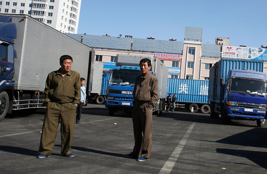 North Korean truck drivers wait for cargo in the Dandong customs center on the Sino-North Korean border October 11, 2006.  DPRK, north korea, china, dandong, border, liaoning, democratic, people's, rebiblic, of, korea, nuclear, test, rice, japan, arms, race, weapons, stalinist, communist, kin jong il