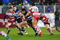 Ben Tapuai of Bath Rugby takes on the Gloucester Rugby defence. Anglo-Welsh Cup match, between Bath Rugby and Gloucester Rugby on January 27, 2017 at the Recreation Ground in Bath, England. Photo by: Patrick Khachfe / Onside Images