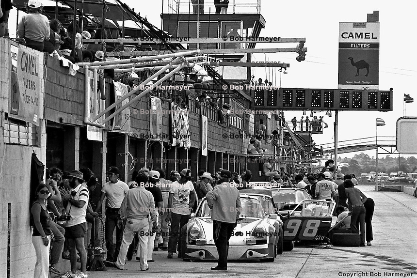 The Sebring pit lane in 1977, dominated by the Camel signage of series sponsor RJ Reynolds.