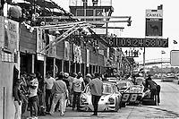 The Sebring pit lane in 1977, dominated by the Camel signage of series sponsor RJ Reynolds.