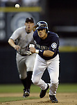 .Seattle Mariners' Kenji Johjima is thrown out by Colorado Rockies'  shortstop Clint Barmes on a doubleplay in the sixth inning in Seattle on June 30, 2006.Jim Bryant/PI Photo.Jim Bryant Photo. ©2010. ALL RIGHTS RESERVED.