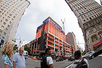 Construction on the University Center building of the New School for Social Research in Greenwich Village is seen on Sunday, May 27, 2012. The 16-story, multi-purpose building will house classrooms,  an auditorium and a dormitory and is scheduled to be completed in 2013 at the cost of $353 million. It was designed by Roger Duffy of Skidmore, Owings & Merrill.  (© Frances M. Roberts)