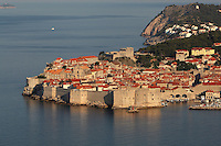The medieval walled city with its defensive walls and the old harbour, protected by the 14th century Fortress of St John or Mulo Tower, Dubrovnik, Croatia. The city developed as an important port in the 15th and 16th centuries and has had a multicultural history, allied to the Romans, Ostrogoths, Byzantines, Ancona, Hungary and the Ottomans. In 1979 the city was listed as a UNESCO World Heritage Site. Picture by Manuel Cohen