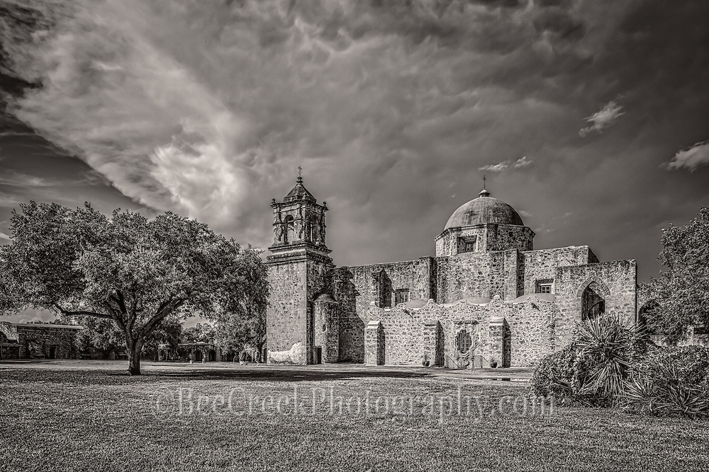This is another view in black and white of the of the historic Mission San Jose y San Miguel de Aguayo a Catholic mission in San Antonio. This is one of the many mission built back in the 1700s that have been well preserved and or still functioning as a church today. This historic landmark was a spanish mission community which was design to convert the indians of the area to the catholic religion. These missions are now part of the world heritage site, along with the San Antonio Missions National historic Park. These mission are visited by many tourist and they have become a travel destination for many who visit San Antonio. Watermark will not appear on image