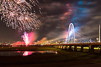 Opening ceremony party and fireworks for the newly constructed (2012) Margaret Hunt Hill bridge, designed by Santiago Calatrava, with the night lights of Dallas, Texas in the background.
