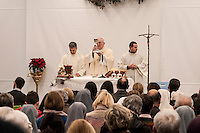 """ROME, ITALY -  DECEMBER 24:  Cardinal Pope's vicar for the Diocese of Rome, Agostino Vallini  during  Christmas Mass at the hostel """"Don Luigi Di Liegro"""" to Termini Station, with the  guests of Caritas on December 24, 2016 in Rome, Italy. (Photo by Stefano Montesi/Corbis via Getty Images)"""