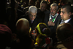 Palestinian President Mahmud Abbas light candles between Fatah members in the west Bank city of Ramallah on 31 December 2009, on the eve of the party's 45th anniversary of its armed struggle. The secular Fatah movement led by Abbas vowed to step up its struggle against the Israeli occupation with demonstrations and diplomacy. Photo by Issam Rimawi