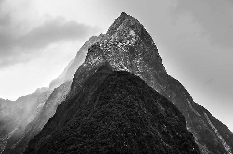 Close up portrait of Mitre Peak (in black and white), surrounded by cloud, Milford Sound, Fiordland National Park, South Island, New Zealalnd- stock photo, canvas, fine art print
