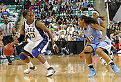 Duke's Karima Christmas looks to go around UNC guard Italee Lucas. This was the Championship game of the 2011 ACC Tournament in Greebsboro on March 6, 2011. Duke beat UNC 81-66. (Photo by Al Drago)