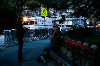 People talk on their phones near a NYPD's truck while police patrol the streets of central park in New York.  06/05/2015. Eduardo MunozAlvarez/VIEWpress