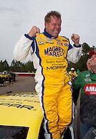 Mar 16, 2014; Gainesville, FL, USA; NHRA pro stock driver Allen Johnson celebrates after winning the Gatornationals at Gainesville Raceway Mandatory Credit: Mark J. Rebilas-USA TODAY Sports