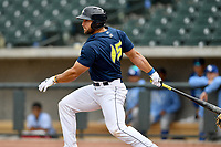 Left fielder Tim Tebow (15) of the Columbia Fireflies gets a hit in the ninth inning in a game against the Lexington Legends on Sunday, April 23, 2017, at Spirit Communications Park in Columbia, South Carolina. Lexington won, 4-2. (Tom Priddy/Four Seam Images)