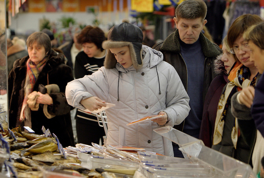Moscow, Russia, 03/01/2004..Customers in the fresh seafood section at the Mosmart shopping mall.