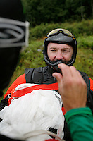 Robert Pecnik discuss the small margins of the competition wiht a fellow BASE jumper. World BASE Race held in Innfjorden, Norway, where BASE jumpers in wingsuits compete in flying down the mountain. The winner is called the World's Fastest Flying Human Being..©Fredrik Naumann/Felix Features.