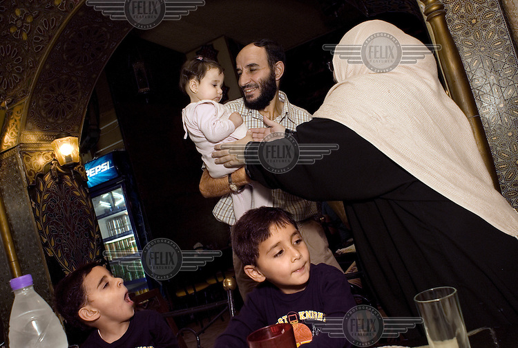 The Mutaz family,  celebrate the end of Ramadan, Eid ul-Fitr, in a restaurant in Amman. They are part of the Palestinian community in Jordan that makes up roughly 50% of the country's population...