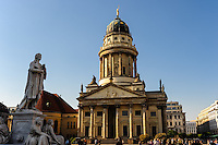 Berlin, Germany. The Gendarmenmarkt is a large and famous square in Berlin. Französischer Dom, French Cathedral, reconstructed in 1981. Friedrich Schiller statue.