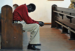 A man prays during a worship service of Nuer refugees from South Sudan who live in Cairo, Egypt. The service took place at St Andrews United Church of Cairo.