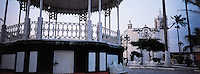 The kiosk and church in the central plaza of Tlacotalpan Veracruz, 2002. The colonial port of Tlacotalpan is one of the best preserved small cities in mexico, it was declared a World Heritage town.  It is also the epicenter of the Cuban-Spanish influenced  Son Jarocho music.