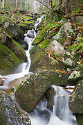 Cascade along Porcupine Brook, a tributary of Lost River, in Kinsman Notch of Woodstock, New Hampshire USA during the autumn months.