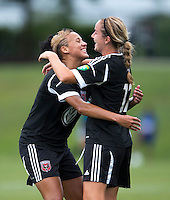 Lianne Sanderson (10) of the D.C. United Women celebrates a goal with teammate Hayley Siegel (12) during the game at the Maryland SoccerPlex in Boyds, Maryland.  The D.C. United Women defeated the Virginia Beach Piranhas, 3-0, to advance to the W-League Eastern Conference Championship.