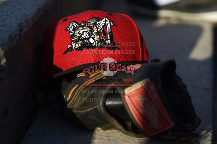 Batavia Muckdogs hat and glove sitting on the dugout steps during a game against the Auburn Doubledays on June 14, 2014 at Dwyer Stadium in Batavia, New York.  Batavia defeated Auburn 7-2.  (Mike Janes/Four Seam Images)