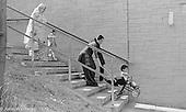 Asian ladies negotiating the steps, Wester Hailes, Scotland, 1979.  John Walmsley was Photographer in Residence at the Education Centre for three weeks in 1979.  The Education Centre was, at the time, Scotland's largest purpose built community High School open all day every day for all ages from primary to adults.  The town of Wester Hailes, a few miles to the south west of Edinburgh, was built in the early 1970s mostly of blocks of flats and high rises.