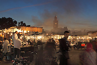 Stalls in Djemma el Fna square and marketplace at night, Medina, Marrakech, Morocco. The minaret of the Koutoubia mosque can be seen in the background. Picture by Manuel Cohen