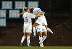 24 September 2009: North Carolina's Alyssa Rich (00) celebrates scoring the game winning goal with Katie Klimczak (89) and Rachel Givan (16). The University of North Carolina Tar Heels defeated the Duke University Blue Devils 2-1 in sudden victory overtime at Fetzer Field in Chapel Hill, North Carolina in an NCAA Division I Women's college soccer game.
