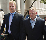 NEW HAVEN, CT-26 JULY 2012--072612JS01- Paul Rogers, right, makes his way out of New Haven Federal Court on Thursday after pleading not guilty as part of an indictment to funnel illegal campaign donations to Chris Donovan's former campaign manager. <br />