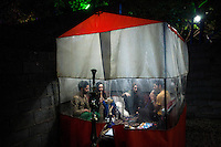 Two young couples sit inside a tent smoking a shisha (sheesha, Narghile, Hookah), an act that has been banned for women in public.