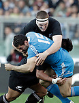 Rugby: test match Italia vs Nuova Zelanda. Roma, stadio Olimpico, 17 novembre 2012..Italy's Andrea Masi, foreground, is tackled by New Zealand's Brodie Retallick during an international rugby test match between Italy and New Zealand at Rome's Olympic stadium, 17 November 2012..UPDATE IMAGES PRESS/Riccardo De Luca