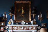 A portrait of the 4th Earl of Dunraven hangs above the marble mantelpiece in the library