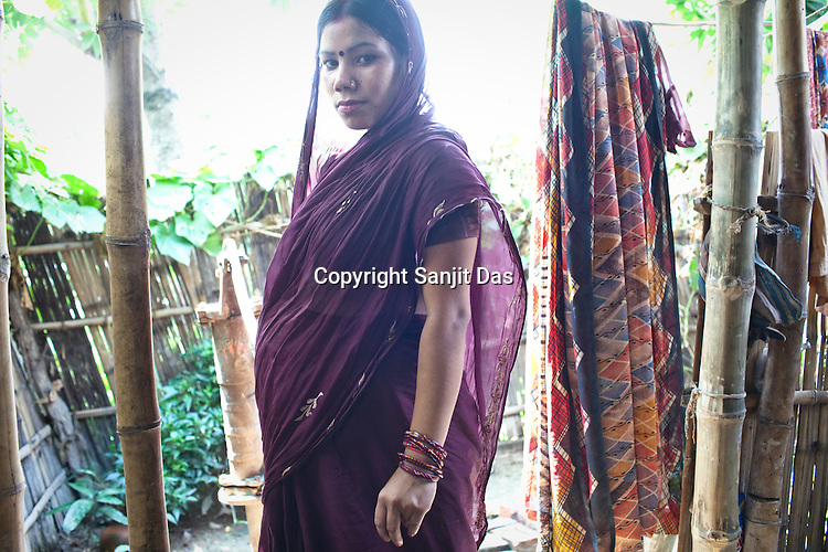 7 month pregnant, Archana Devi poses for a portrait in her house in Village Sanau Sultan in Seohar district of Bihar, India. Since 2008 the Foundation and Geneva Global have been investing in the training of medical staff to improve the lives of people living in 600+ villages in the region. The NGOs are delivering cost effective interventions to address treatment, care and prevention of diseases, disability and preventable deaths amongst infants, adolescent girls and women of child-bearing age. There is statistical and anecdotal evidence that there have been vast improvements and a total of 40-50% increased immunization for all children under 6 has meant that communities can be serviced and educated long term. Photograph: Sanjit Das/Panos for Geneva Global
