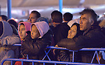 A refugee family from Afghanistan watches as a ferry docks at night on the Greek island of Chios. They came to the island by crossing the Aegean Sea on a small boat from Turkey. Upon arrival, they were registered and provided with food and shelter in a reception center built with support from International Orthodox Christian Charities, a member of the ACT Alliance. Now they are moving on to Athens, and from there on to western Europe. Hundreds of thousands of refugees and migrants have passed through Greece in 2015.