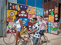 Murals on the walls in the Bushwick neighborhood of Brooklyn in New York on Saturday, July 27, 2013. The neighborhood is undergoing gentrification changing from a rough and tumble mix of Hispanic and industrial to a haven for hipsters, forcing many of the long-time residents out because of rising rents.. (©Richard B. Levine)